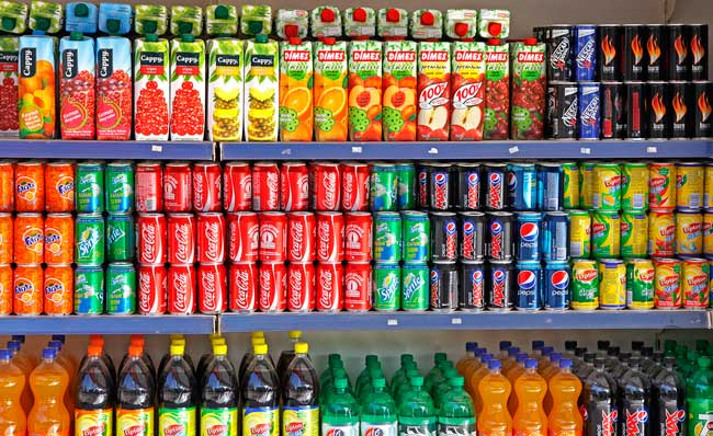 bigstock-Bottles-Of-Soft-Drinks-On-A-Ma-55681343