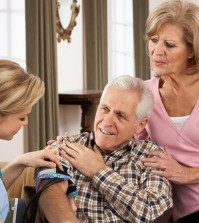 Health Visitor Taking Senior Man's Blood Pressure