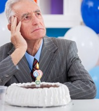 Senior men sitting front of cake birthday ask yourself how old a