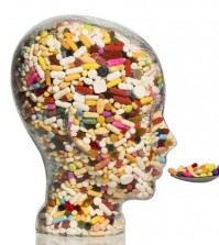 a glass head filled with many tablets. photo icon for drugs