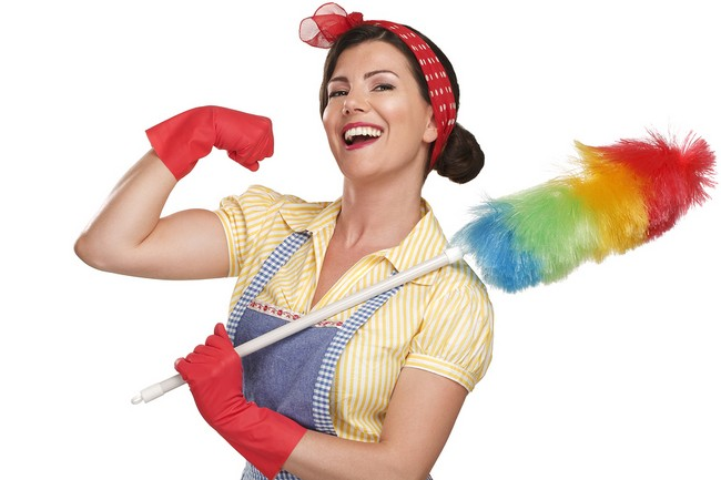 young happy beautiful woman maid dusting on white background