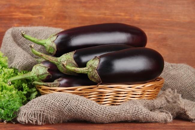 Fresh eggplants in wicker