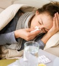 Sick Woman.Flu.Woman Caught Cold. Sneezing into Tissue. Headache