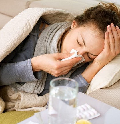 Sick Woman.Flu.Woman Caught Cold. Sneezing into Tissue. Headache