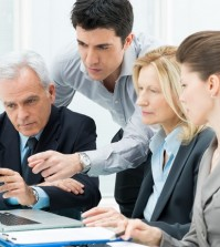 Business People Working Together On A Laptop