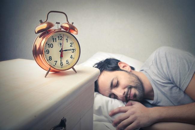 young man sleeping well