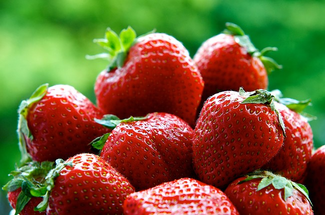 Fresh strawberries on summer with green background, strawberries