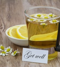 Get well card, chamomile tea and fresh lemon