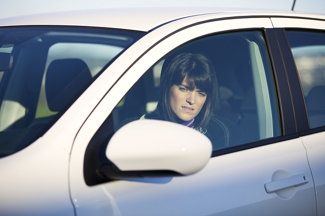 Beautiful woman driving her new white car