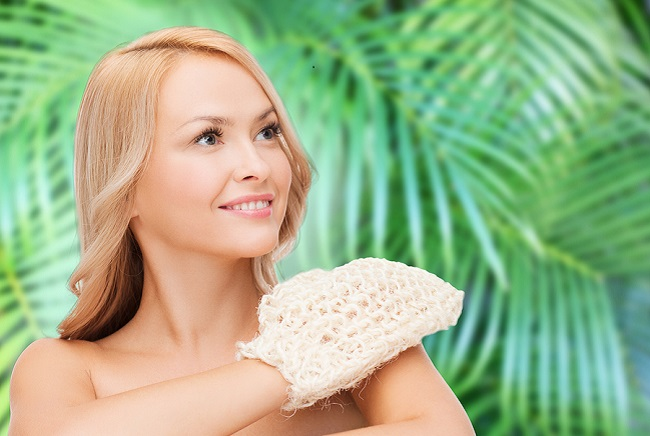 health, spa and beauty concept - smiling woman with exfoliation
