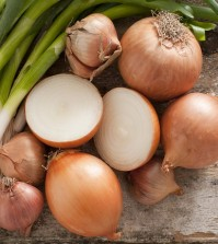 Assorted Farm Fresh Onions On A Rustic Table
