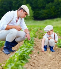 Father And Son Gardening On Their Homestead