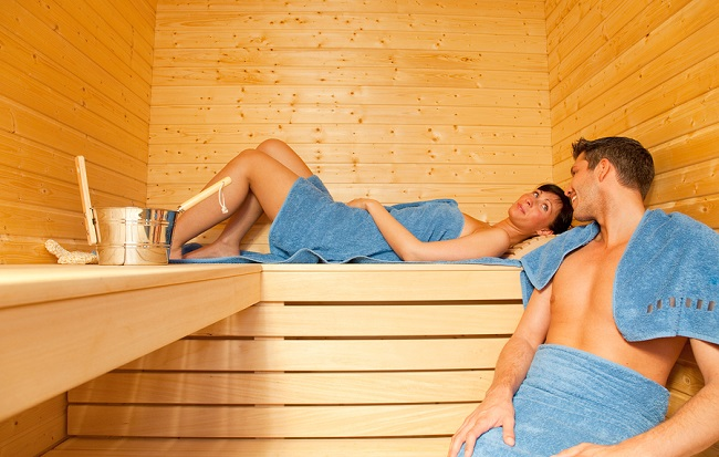 Young couple while beauty health spa treatment taking a sauna
