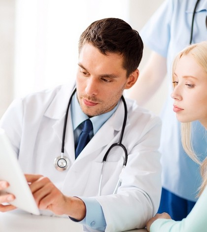 healthcare, medical and technology - doctor showing something pa