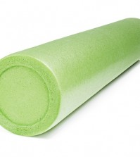 A green foam roller isolated on white with natural shadows. Foam
