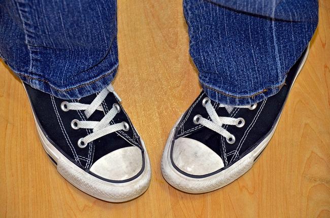 pigeon-toed teen in sneakers
