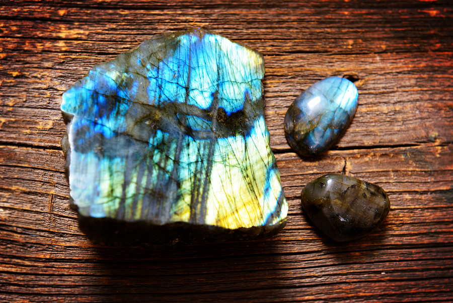 Polished labradorite crystals on wooden board