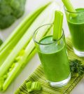 Healthy green smoothie on table celery and broccoli juice mix