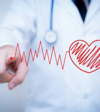 finger write red heart with the heart is a part of a cardiogram Concept of medical examination.
